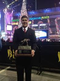 Cole Mazza of Alabama holds his Chris Rubio Award trophy in Los Angeles